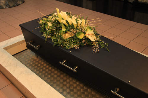 A casket is rectangular, and offers a soft bed for the body's final rest. (Shutterstock)