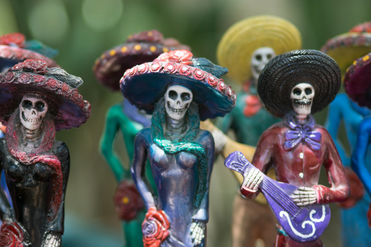 Dressing as Catrina is a traditional part of Dia De Muertos for women. (Getty Images)
