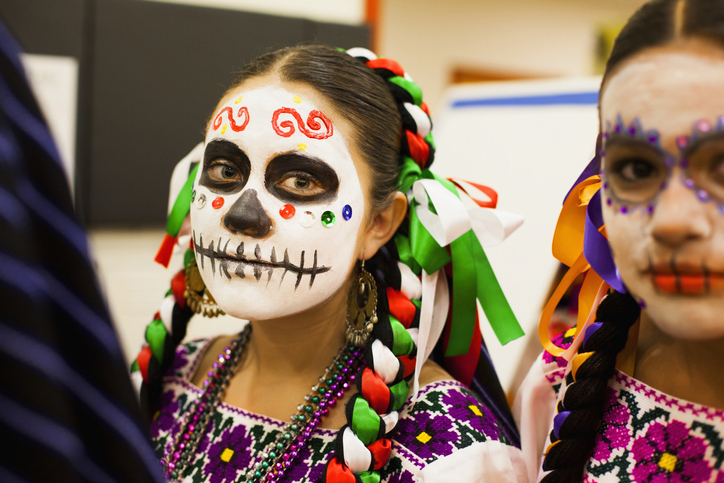 While dressing up in colorful, exciting clothing is a big part of Dia de Muertos, the attire is not appropriate for a Halloween costume. (Getty Images)