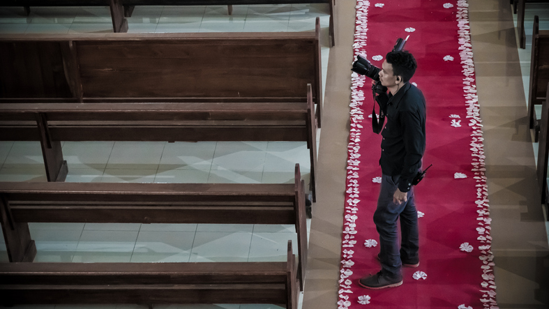 If photos are desired, the family should arrange for a professional photographer or other designated individual to take photos during the service. (Getty Images)