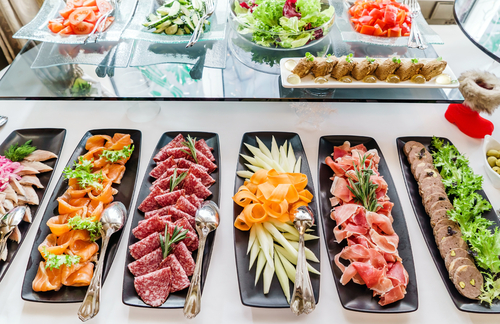 A spread of appetizers is more common than a formal, private meal these days. (Shutterstock)