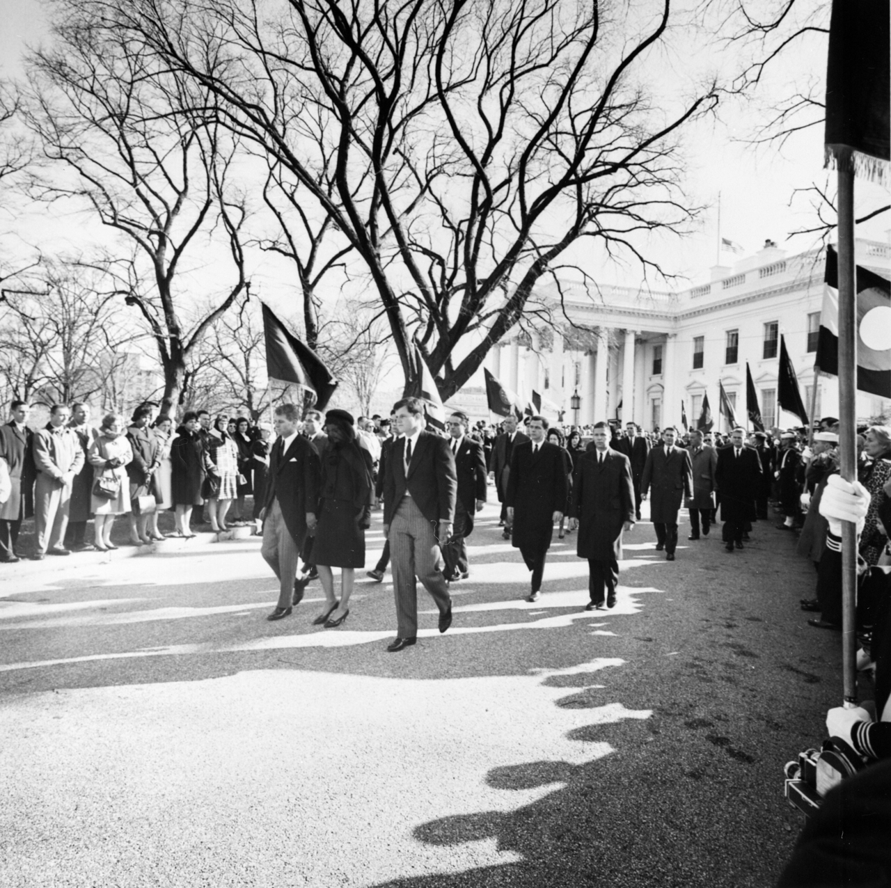 Jacqueline Kennedy, her brothers-in-law, Attorney General Robert F. Kennedy and Senator Edward Kennedy, walk from the White House as part of the funeral procession accompanying President Kennedy's casket to St. Matthew's Cathedral, on November 25, 1963. (Abbie Rowe White House Photographs)