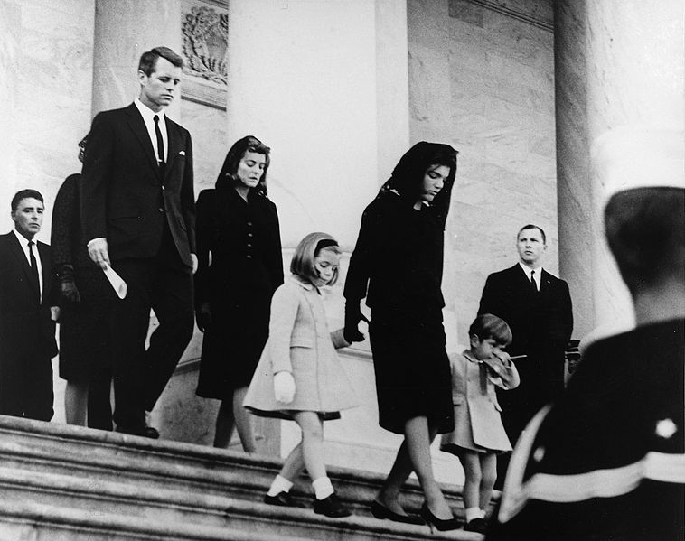 President's Family leaves Capitol after Ceremony. Caroline Kennedy, Jacqueline Bouvier Kennedy, John F. Kennedy, Jr. (2nd row) Attorney General Robert F. Kennedy, Patricia Kennedy Lawford (hidden) Jean Kennedy Smith (3rd Row) Peter Lawford. United States Capitol, East Front, Washington, D.C.  (Abbie Rowe White House Photographs)