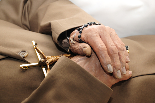 Ideally, a priest administers the final blessing to a dying Catholic. However, other Catholics may perform Last Rites if a priest is not available. (Shutterstock)