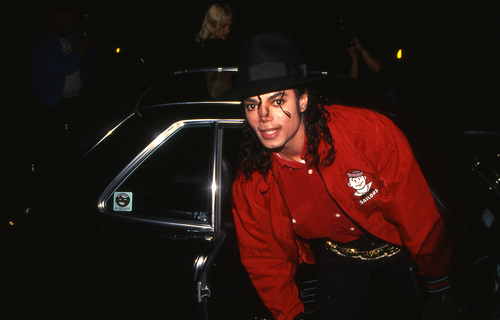 LOS ANGELES, CALIFORNIA - Exact date unknown - circa 1990 - Michael Jackson arriving at a celebrity event. (Shutterstock)
