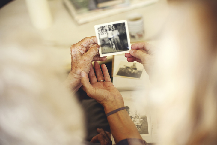 Find old photos, share memories with family, and research your mom's life to capture the best version of her story. (Getty Images)