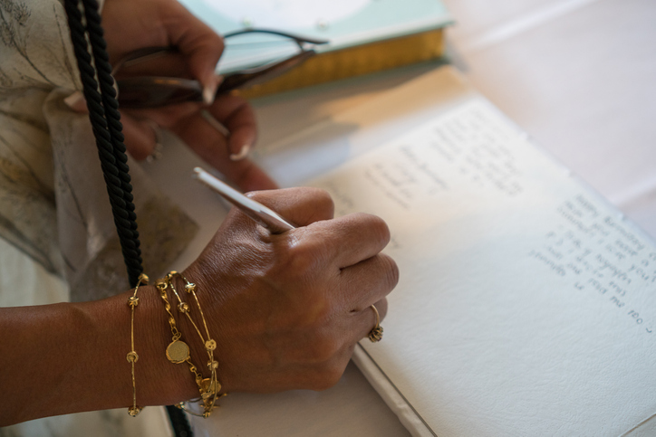 The digital guestbook is a modern replacement for the funeral register book. While it's appropriate to sign your name to acknowledge you read the story, a longer tribute can be more meaningful. (Getty Images)