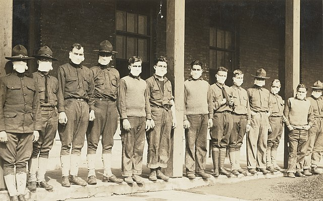 Medical Department - Influenza Epidemic 1918 - Spanish influenza in army hospitals. Medical and quartermaster corps men in connection with the United States Army Hospital Number 4, Fort Porter, New York wore masks while at work around the hospital. (National Archives and Records Administration/Wikimedia Commons)