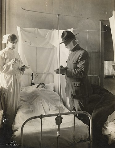 Medical Department - Influenza Epidemic 1918 - Spanish Influenza in army hospitals. Masks and cubicles used in United States of America General Hospital Number 4, Fort Porter, New York. Patients' beds are reversed, alternately so breath of one patient will not be directed toward the face of another. (National Archives and Records Administration/Wikimedia Commons)