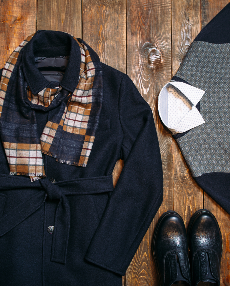 901113e92be8 Formal shoes, a scarf and winter jacket are essentials for a winter funeral.  (