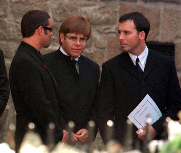 Singers Elton John (centre) and George Michael leaving Westminster Abbey after the funeral service for Princess Diana, Princess of Wales, 6th September 1997. Elton John's partner David Furnish is on the right. (Photo by Jayne Fincher/Getty Images)