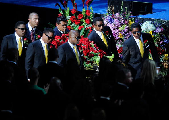 LOS ANGELES, CA - JULY 07: The Jackson Brothers (L-R) Randy, Marlon, Jackie, Jermaine and Tito accompany the casket into the Michael Jackson public memorial service held at Staples Center on July 7, 2009 in Los Angeles, California. Jackson, 50, the iconic pop star, died at UCLA Medical Center after going into cardiac arrest at his rented home on June 25 in Los Angeles, California. (Photo by Kevork Djansezian/Getty Images)