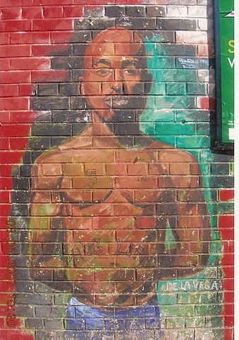 Graffiti of Tupac in East Harlem, New York City. (Wikimedia Commons/JJ & Special K)
