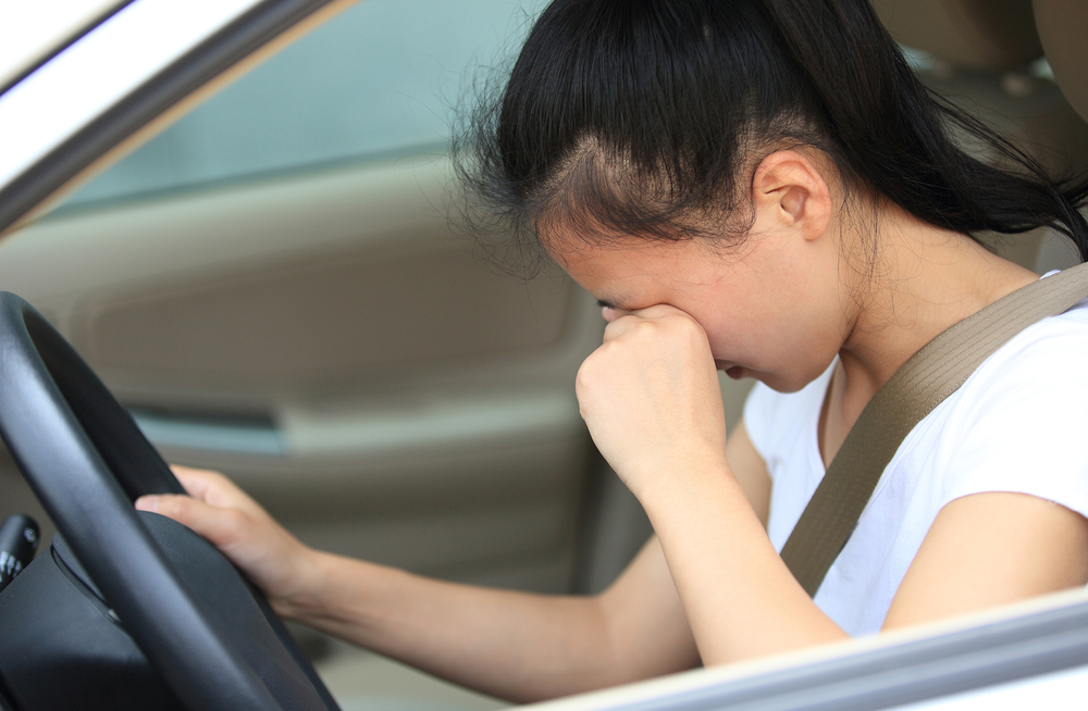 Tears blur your vision, and take focus from the road. Crying is healthy—just make sure you're safely parked before risking an accident on the road. (Shutterstock)