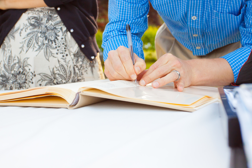 Sign the guestbook with your name and heartfelt condolences. (Shutterstock)